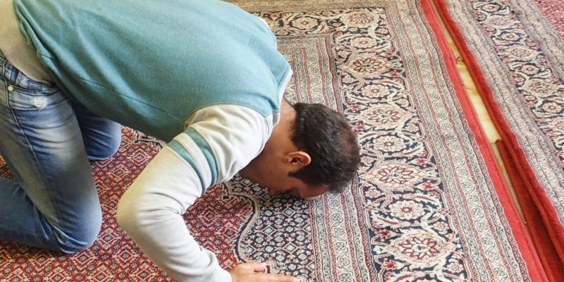 Muslim on Prayer Rug